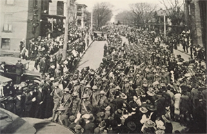 "Original photo caption from newspaper clipping: ""Knoxville's Welcome Home"" A Company of the 117th Infantry, with helmets and gas masks on and bayonets fixed, in the homecoming parade, April 5, 1919."